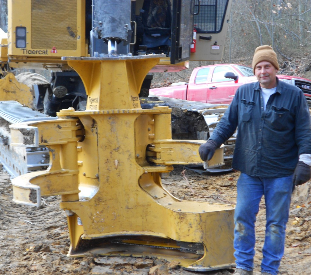 Jimmy with his Tigercat bar saw.