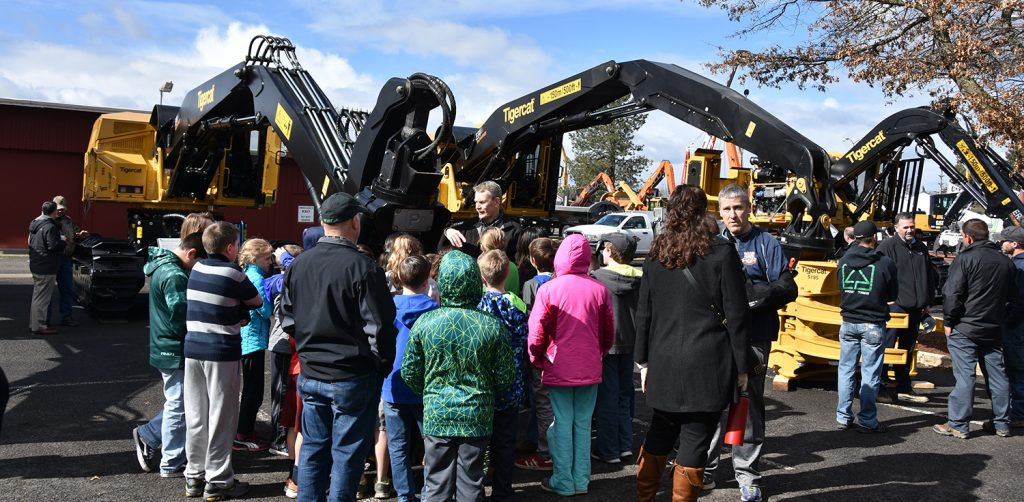 Triad Machinery's Andy Hunter spent much of his day Thursday, explaining the process of felling trees to interested 4th and 5th graders who visited the Triad Machinery show booth.